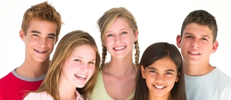 a group of teenagers smiling