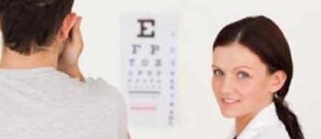 eye care practitioner smiling during eye exam