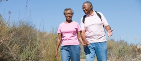 mature couple smiling on a hike
