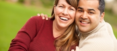 mature man and woman smiling outdoors