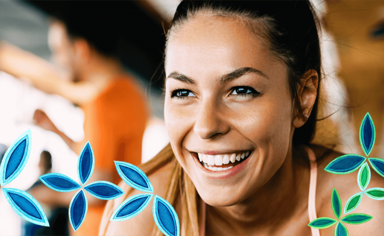 woman smiling and exercising