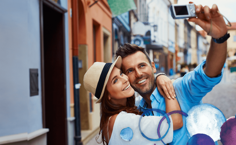 man and woman smiling and taking a picture