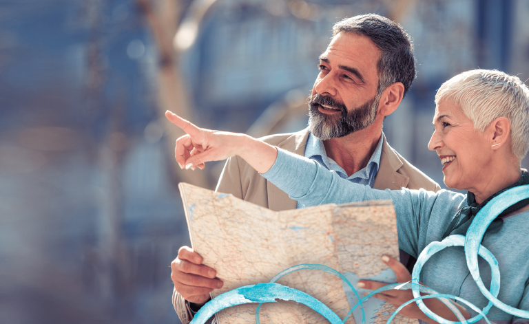 man and woman smiling and holding a map