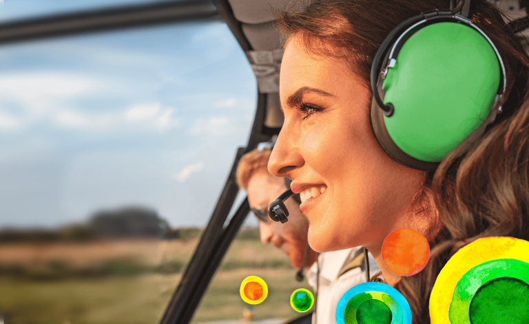 woman smiling in a helicopter