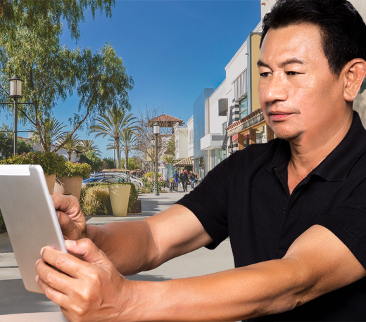 mature man holding a tablet