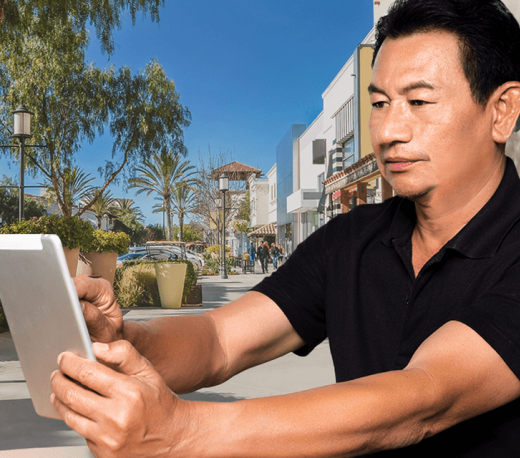 man holding a tablet and smiling